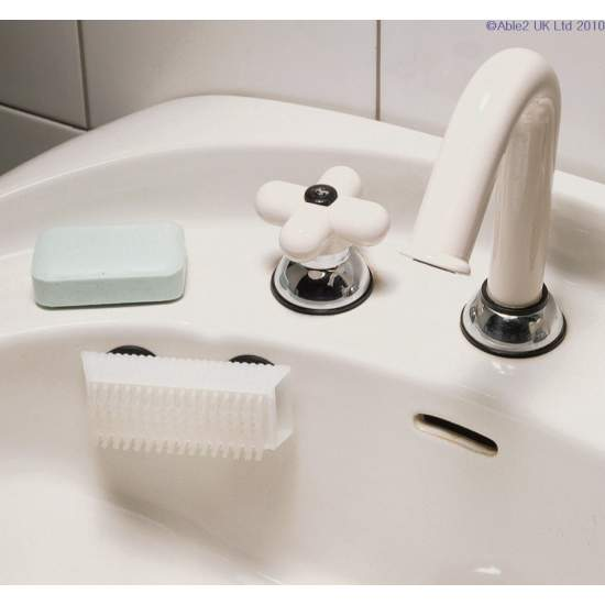 Nail brush with suction cups